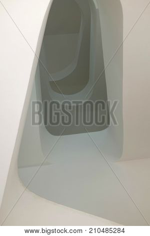 Detail of architectural shapes and shadows in a modern white staircase