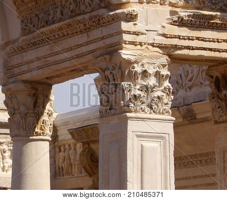 Greek structure with column holding cross members with intricate carvings