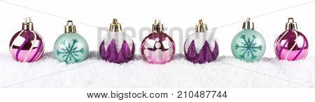 Modern Purple, Pink And Turquoise Christmas Baubles In Snow Isolated On A White Background