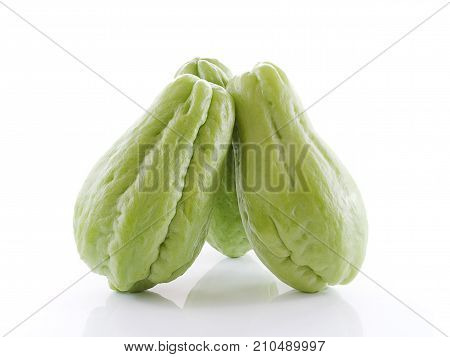 Chayote close up isolated on white background .