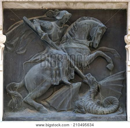 LUCCA, ITALY - JUNE 03: Saint George slaying the dragon relief on the building in the city of Lucca in Tuscany, Italy on June 03, 2017.