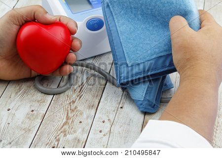 Measuring blood pressure using automatic electronic blood pressure monitor meter. Health care concept