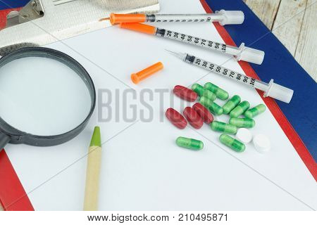 Healthcare concept. Capsule,caplet,tablet and syringe on isolated white background.