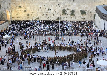 Jerusalem, Israel - Aug 20, 2010:  Jewish people singing and dancing in the Wailing Wall square of Jerusalem old city to celebrate the Sabbath, on Aug 20, 2010.