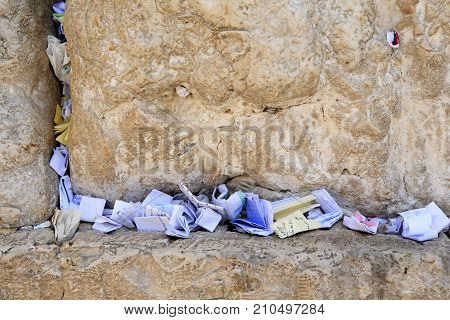Jerusalem, Israel - Aug 20, 2010: Many wish papers in the stone joints of the famous