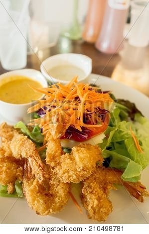 Fried Shrimp Salad with dressing and fruit dressing