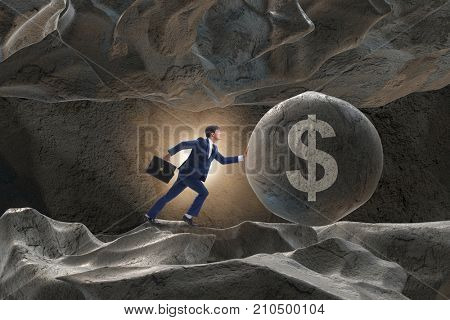 Businessman pushing dollar sign in business concept