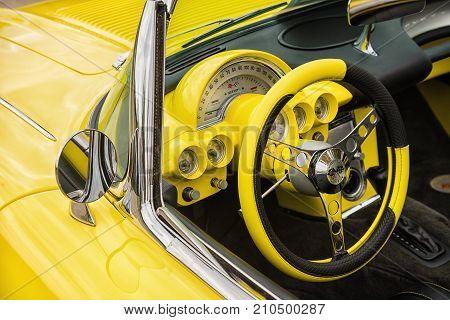Westlake Texas - October 21 2017: Dashboard and steering wheel interior view of a yellow 1958 Corvette Chevrolet convertible classic car.