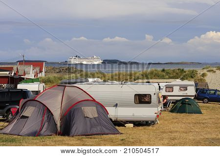 ØLBERG, SOLA, NORWAY ON JULY 07. View of Ølberg camping. White ship in the background on July 07, 2009 in Ølberg camping, Norway. Unidentified people in the camping. Editorial use.