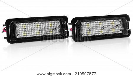 Light bulbs for car lamps. Car led for halo rings and angel eyes lighting effect. Automotive part in Silvery metallic and black color with wires and connecting elements on isolated white background.