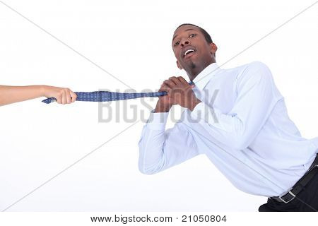 Man being yanked off camera by his tie