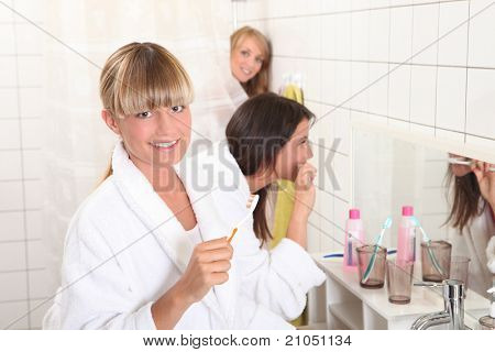Three housemates in bathroom