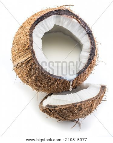 Cracked coconut fruit with coconut milk inside it.