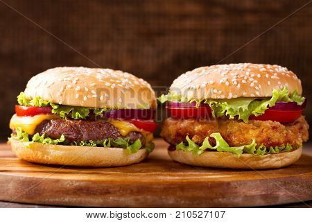 Various Burgers On A Wooden Background