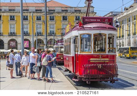Lisbon PORTUGAL June 1 2017. Lisbon Old Red Tram is one of the most important tourist attractions. Line of tourists waiting to take Hills Tramcar Tour in centre of Lisbon