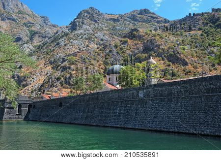 Montenegro Kotor View of the wall of the Old City and the Church of St. Nicholas in the background are seen fortress walls around Kotor the length of more than 4.5 km