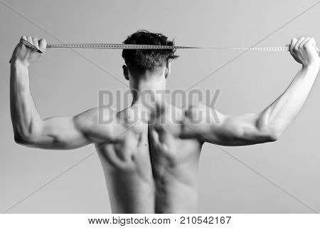 Diet And Healthy Lifestyle Concept: Man With Muscular Back