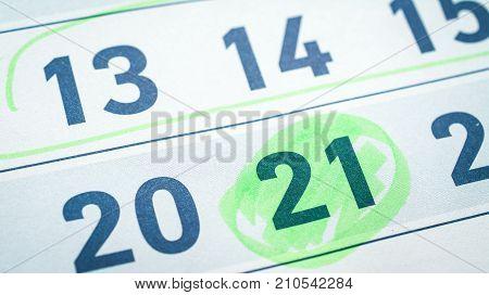 calendar, twenty-one, twenty, fifteenth number, green marker highlights close up