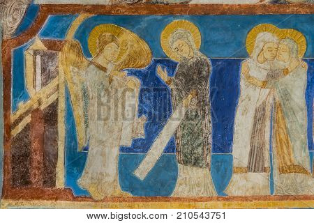 The annunciation Archangel Gabriel tells Mary that she will be pregnant. Mary visits Elisabeth. Fresco in a medieval church. Bjaresjo Sweden September 4 2014