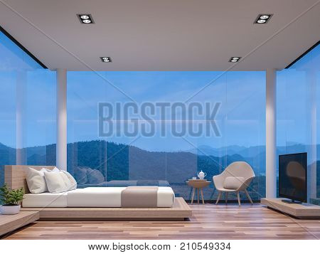 Night scene glass house bedroom with mountain view 3d rendering image.The room has wooden floorThere are large frame less glass window overlooking to the mountain and nature