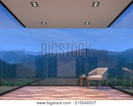 Night scene glass house living room with mountain view 3d rendering image.The room has wooden floor. There are large frame less glass window overlooking to the mountain and nature