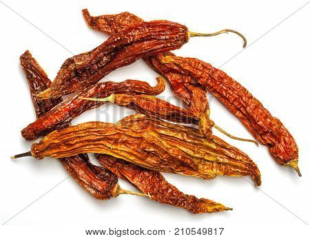 Aji amarillo dry pepper from the Peruvian cuisine. Isolated on white.
