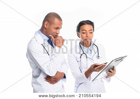 african american doctors in white coats with stethoscopes and diagnosis isolated on white