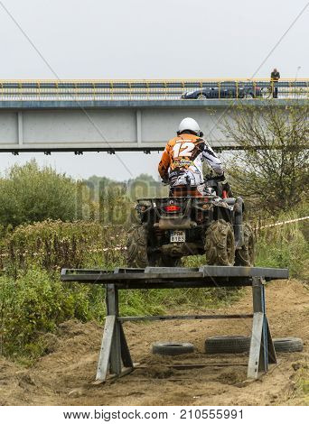 Quad Ride Through A Movable Ramp.