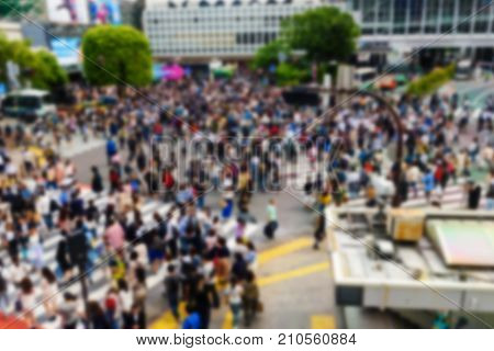 Blurred abstract image of Pedestrians at Shibuya crossing. Here is very famous of scramble crosswalk in the world. Travel destination background with copy space for text.