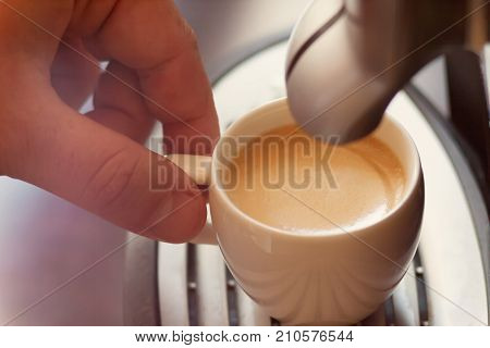 Close Up View Of The Hand Of A Man Working In A Coffee House Preparing Espresso Coffee Waiting For T