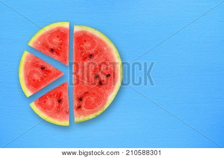 Watermelon slices on blue table top view