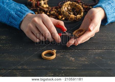 Handmade earrings making home workshop. Woman artisan create tassel jewelry. Art hobby handicraft concept poster