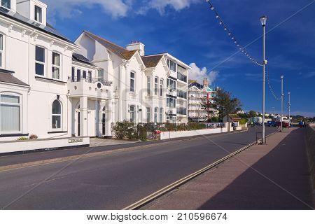 Row of white houses on the coastal street Esplanade. Exmouth. Devon. England