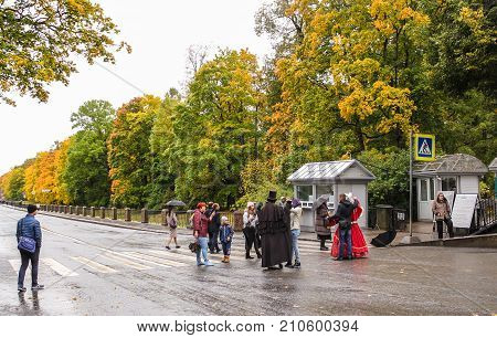 Pushkin, Russia - 5 October, Photographing with mummers, 5 October, 2017. A rainy day in an autumn park.