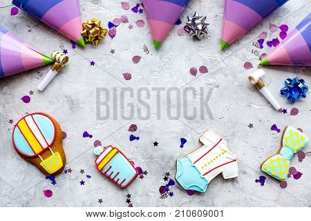 Cook gingerbread cookies for baby shower with ticker tape on stone desk background top view mockup poster