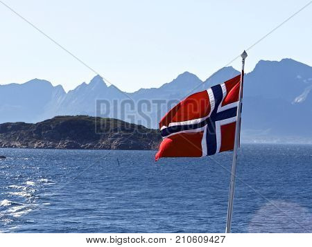Flag of Norway on sea and mountains background