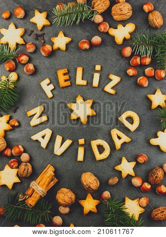 Feliz Navidad Cookies. Words Merry Christmas En Spanish With Baked Cookies, Christmas Decoration And