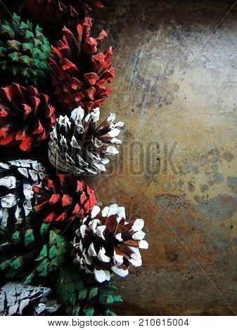 Pine cones on vintage steell background. Christmas, New Year time. Diferent colors.