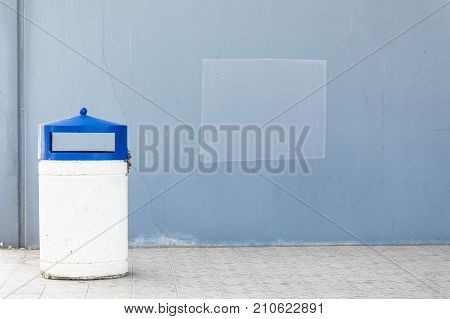 Outdoor dust bin isolated over urban background