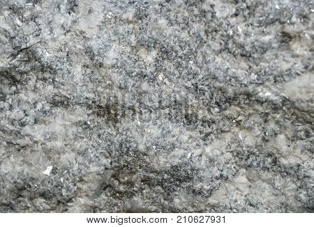 Rock mica texture, stone closeup abstract background.