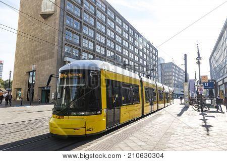 Modern Yellow Tram At Alexanderplatz In Berlin, Germany