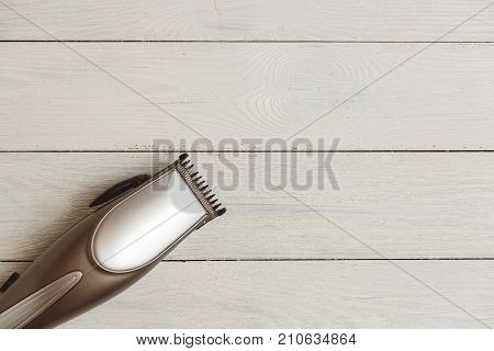 Stylish Professional Barber Clippers, Hair Clippers on wood background with copy space