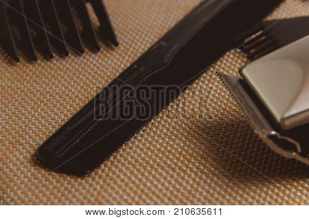 Stylish Professional Barber Clippers, Hair Clippers, Haircut accessories on brown background