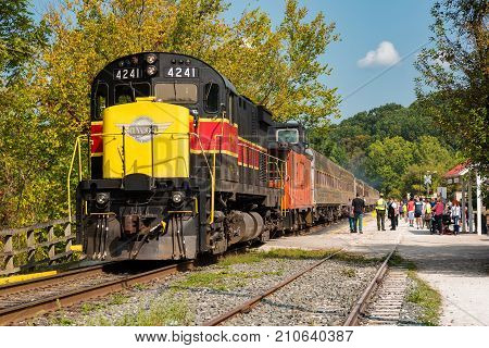 PENINSULA OH - SEPTEMBER 17 2017: The scenic train stops to let passengers on and off at the station in Peninsula during its run on the Cuyahoga Valley Scenic Railroad