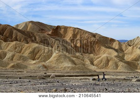 DEATH VALLEY, CALIFORNIA - NOVEMBER 28 2009: Two kids at Zabriskie Point in Death Valley National Park California