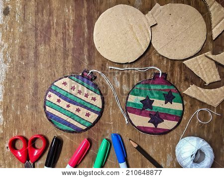 DIY Christmas decorations from cardboard paper. Homemade Christmas ornament from reused paper. Craft Ideas for Kids.
