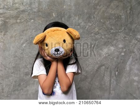 Cute girl holding teddy bear. Fun time playing with a doll