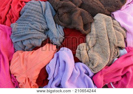 Close up pile of carelessly warm scattered clothes.