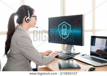 Pretty Female Office Worker Wearing Headset