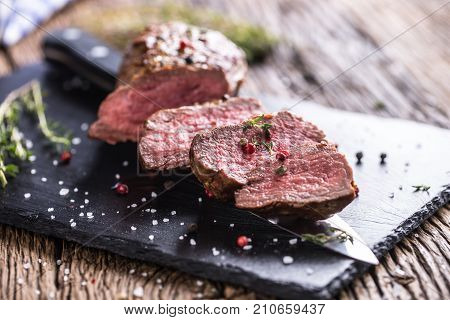 Beef Steak. Roasted Beef Steak With Salt Pepper Thyme On Rustic Wooden Table